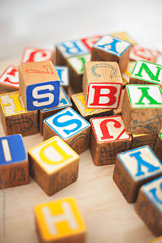 close up of a child's wooden alphabet blocks by Natalie JEFFCOTT for Stocksy United