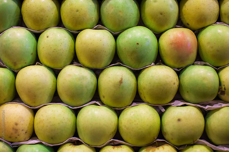 Fresh apples on display at a market by Zocky for Stocksy United