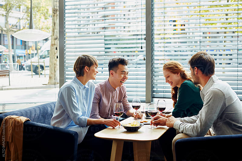 Cheerful Friends Having Wine In Restaurant by ALTO IMAGES for Stocksy United