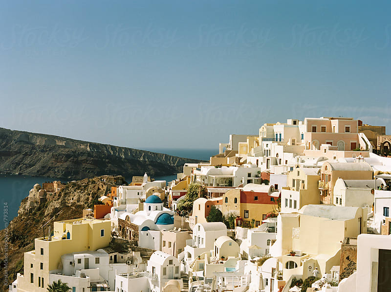 View of buildings in Oia, Santorini by Kirstin Mckee for Stocksy United