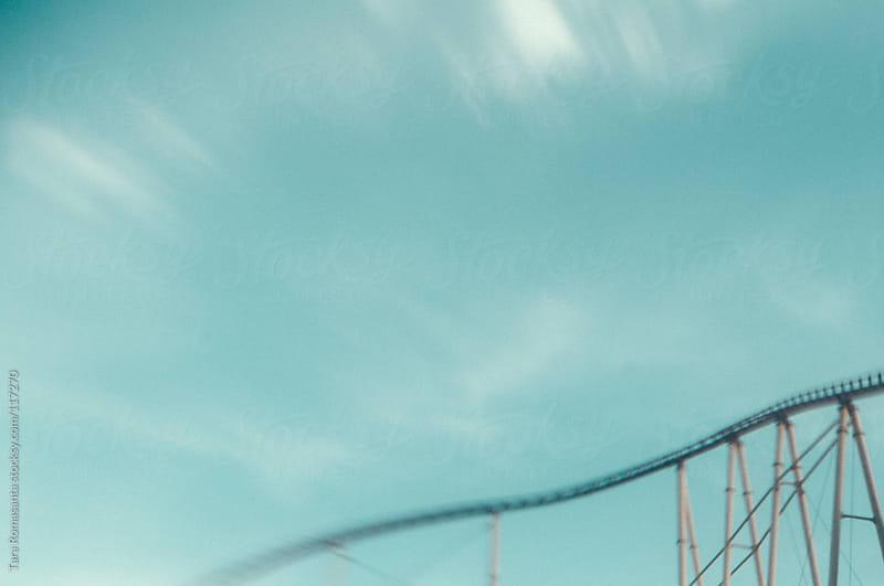 empty roller coaster tracks by Tara Romasanta for Stocksy United
