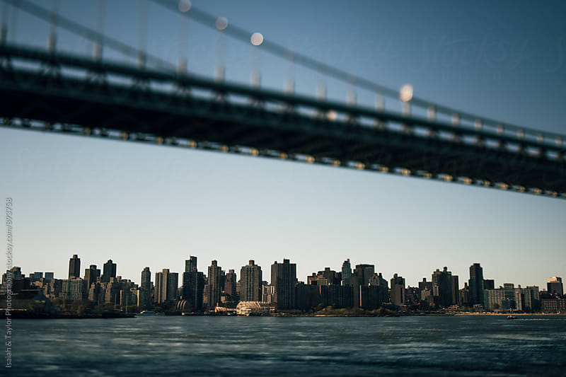 Bridge over water by Isaiah & Taylor Photography for Stocksy United