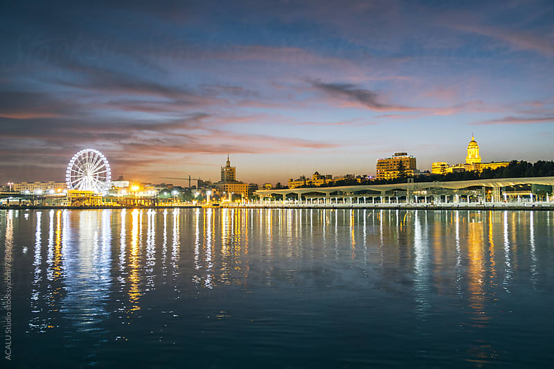 Malaga harbor and skyline illuminated at night, Europe by ACALU Studio for Stocksy United