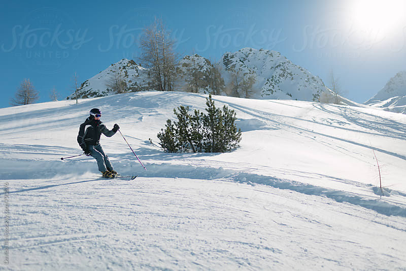 Skier having fun on the snow by Davide Illini for Stocksy United