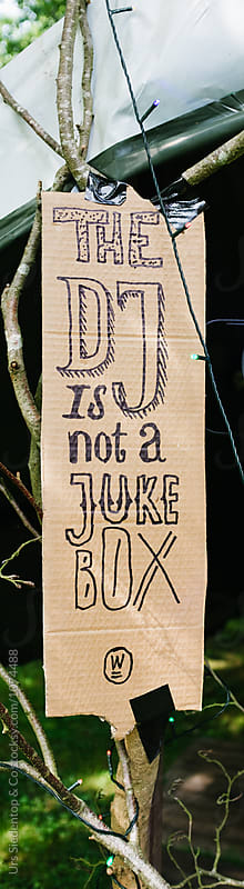 The DJ is not a jukebox sign by Urs Siedentop & Co for Stocksy United