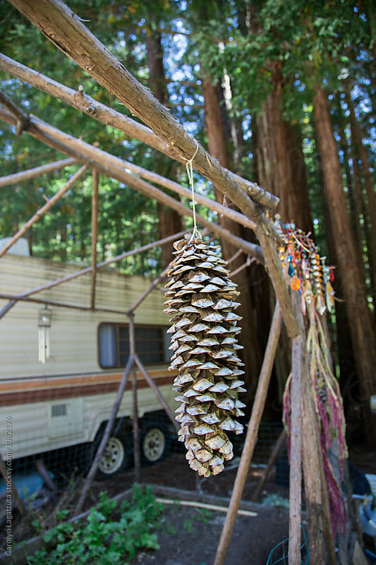 Large pinecone decoration in a camper park by Carolyn Lagattuta for Stocksy United