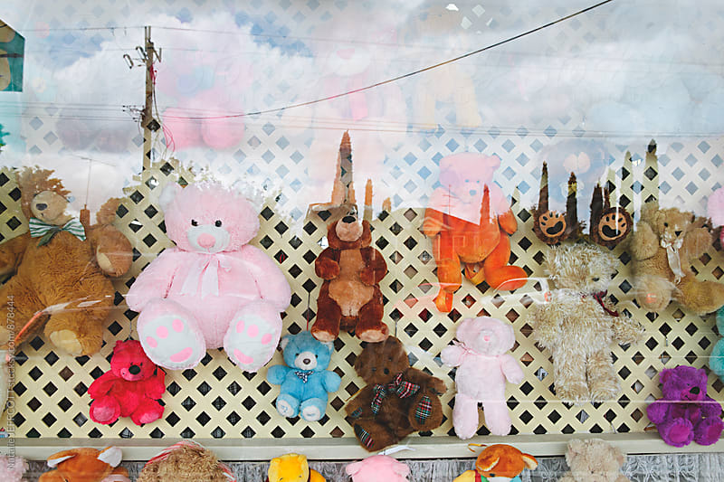 Colourful window display of teddy bears by Natalie JEFFCOTT for Stocksy United