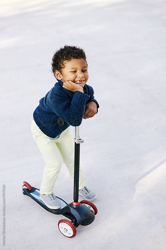 Toddler on a scooter by Marlon Richardson for Stocksy United