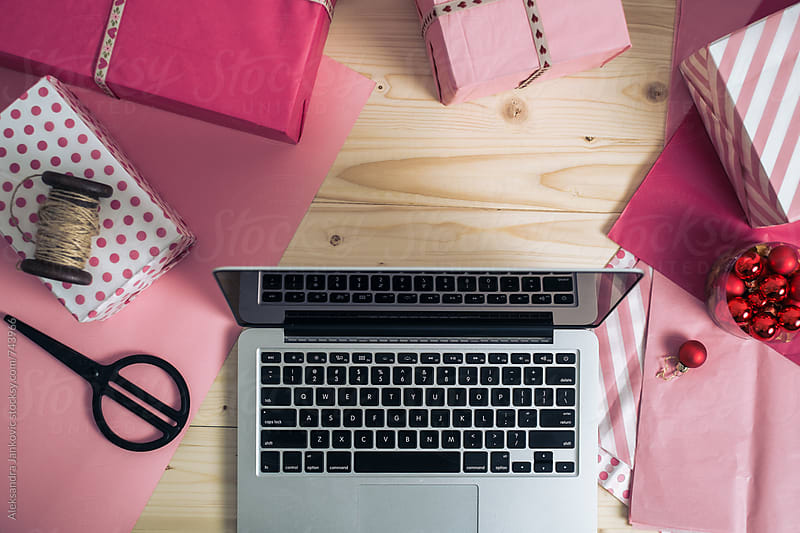 Laptop, Wrapping Paper and Presents on the Desk by Aleksandra Jankovic for Stocksy United