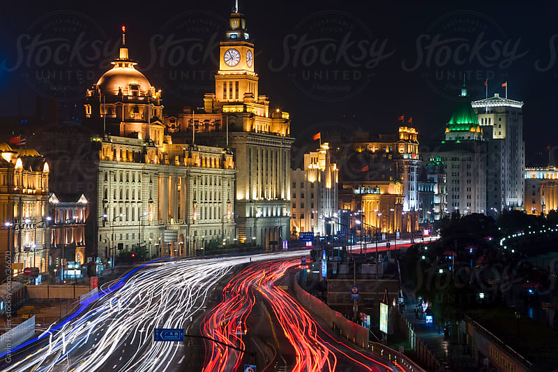 China, Shanghai, Historic Buildings along the Huangpu river and Shanghai's  famous Bund promenade, illuminated at night by Gavin Hellier for Stocksy United