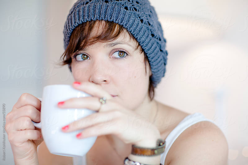 Young woman drinking her morning coffee by Robert Kohlhuber for Stocksy United