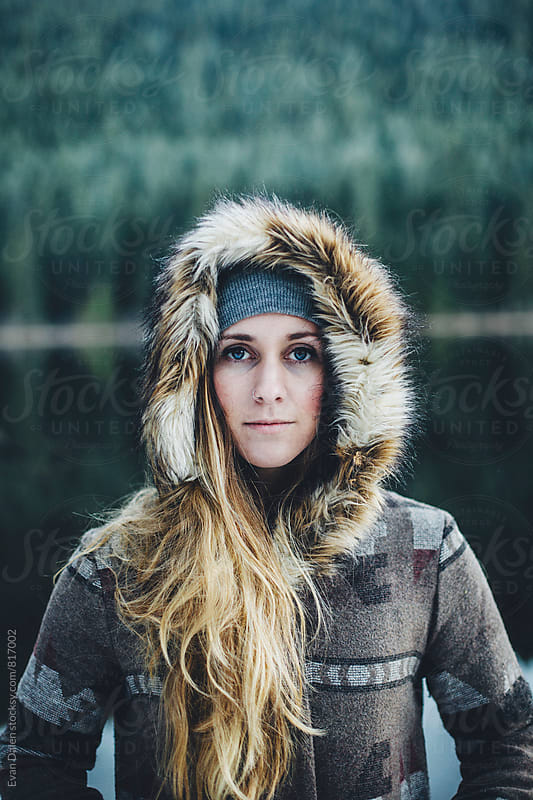 Young Woman In Fur Coat By Freezing Lake by Evan Dalen for Stocksy United
