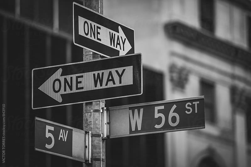 One Way Signs in Manhattan Streets, New York, USA by Victor Torres for Stocksy United