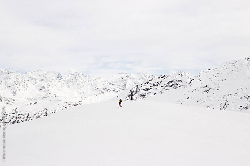 Hiking on snow-covered mountains in winter by michela ravasio for Stocksy United