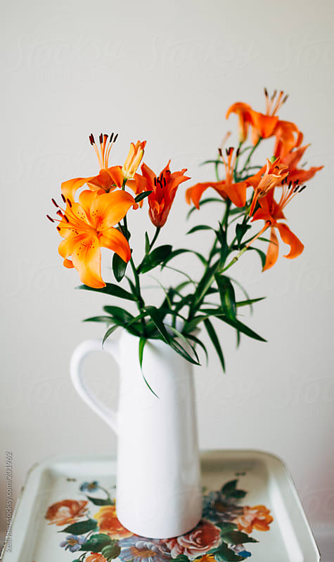 Pitcher of Vibrant Orange Lilies On Vintage Metal Tray by Kelli Seeger Kim for Stocksy United