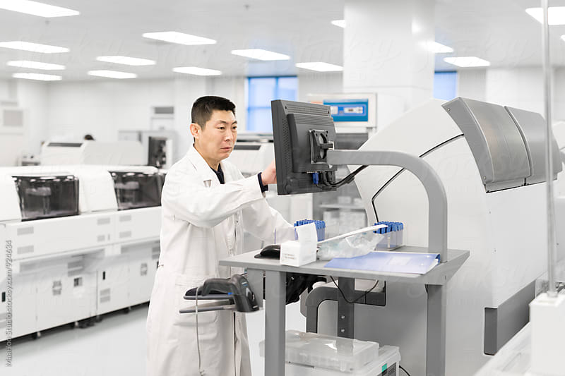 Scientists using equipments in lab by MaaHoo Studio for Stocksy United