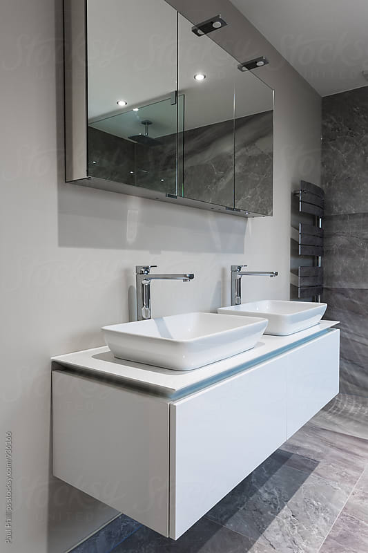 Pair of contemporary washbasins in a modern shower room. by Paul Phillips for Stocksy United