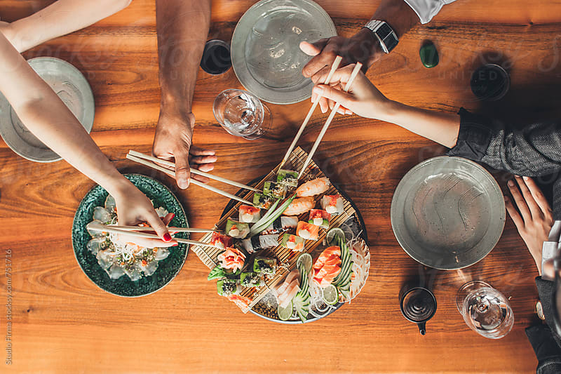 People Eating Sushi by Studio Firma for Stocksy United