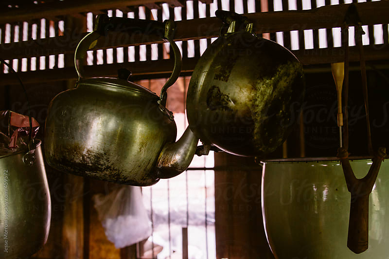 Pots pans and kettle hang in Thai kitchen by Jesse Morrow for Stocksy United