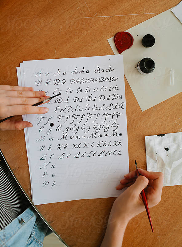 woman write alphabet with straight calligraphy pen by Sergey Filimonov for Stocksy United
