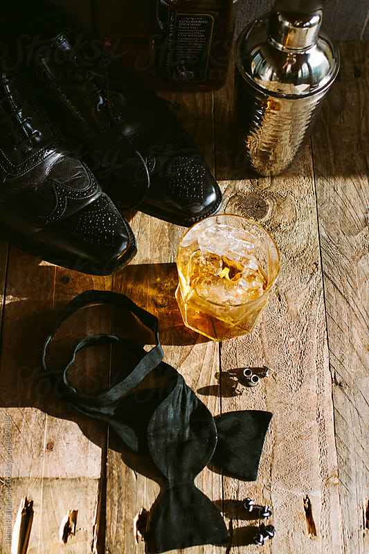 A bourbon-drinking gentleman's things. by Helen Rushbrook for Stocksy United