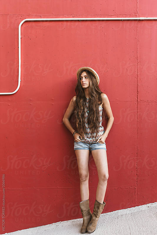 Portrait of a Beautiful Teenager over a Red Background