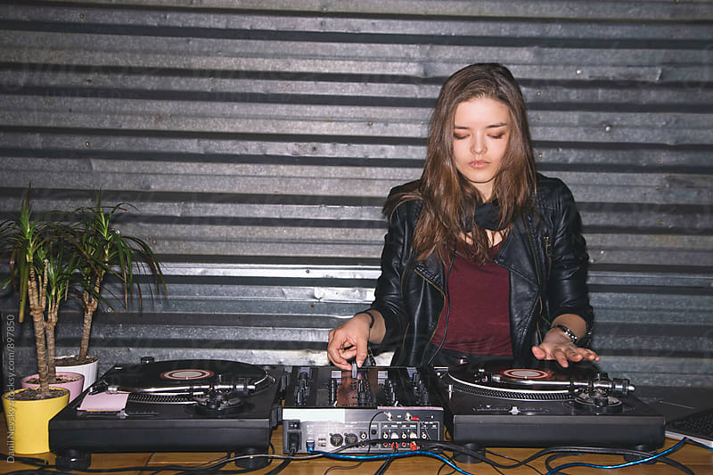 Young female DJ playing music  by Danil Nevsky for Stocksy United