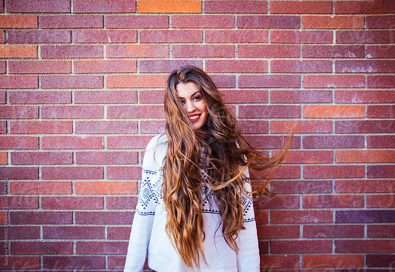 Portrait of young woman with very long hair by Susana Ramírez for Stocksy United