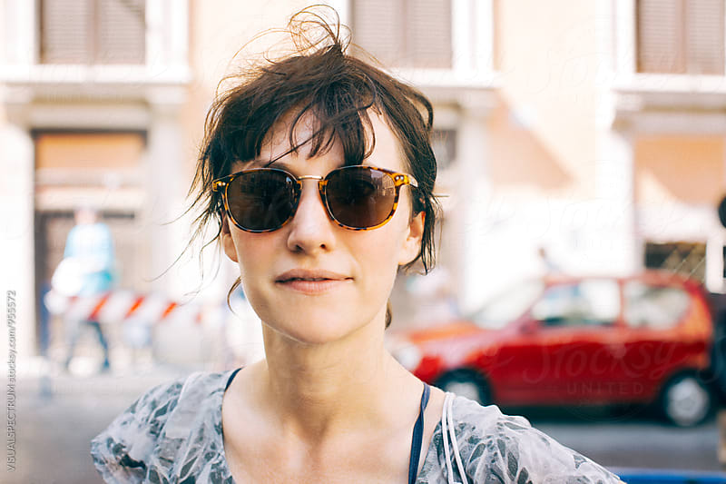Portrait of Caucasian Woman Wearing Sunglasses by VISUALSPECTRUM for Stocksy United