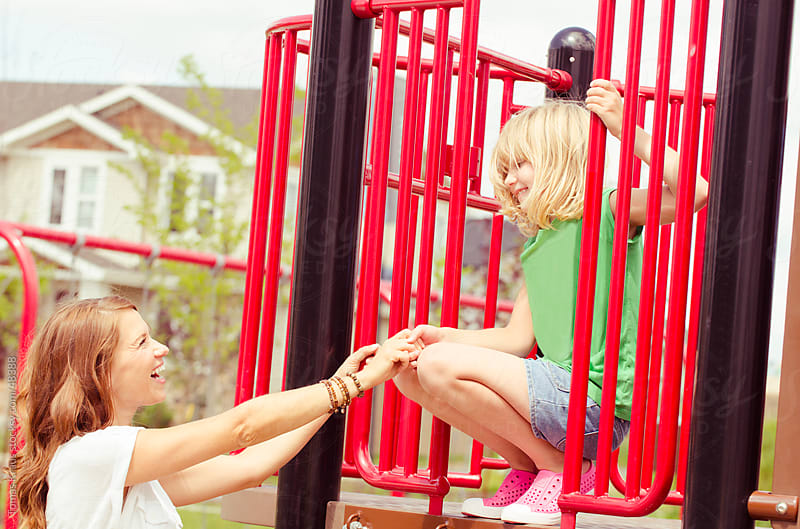 mother and daughter at the playground by Tomas Kraus for Stocksy United