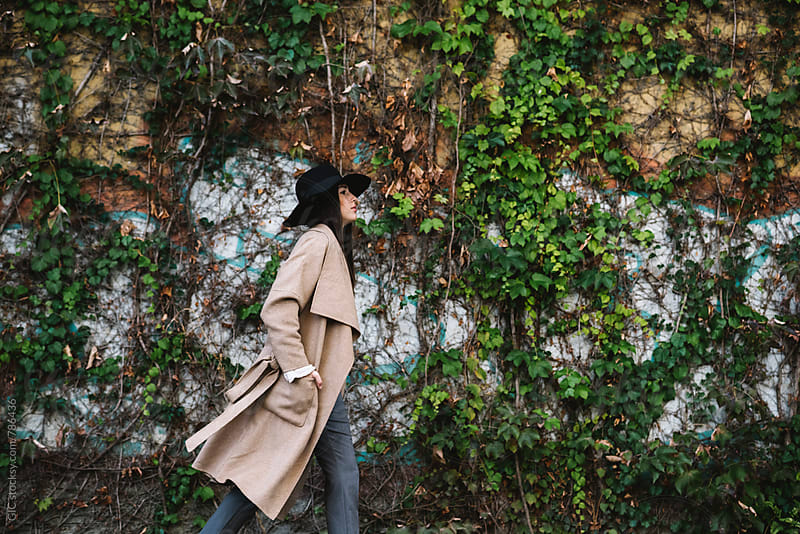 Stylish woman with coat  by Simone Becchetti for Stocksy United