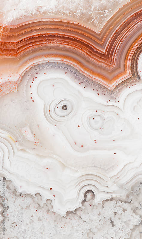 Agate with colorful banding, closeup by Mark Windom for Stocksy United