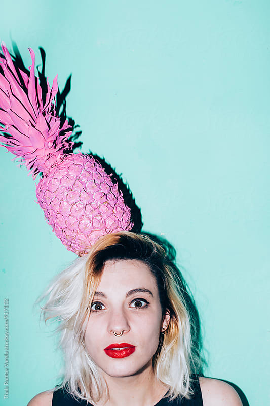 woman witth a pineapple on her head by Thais Ramos Varela for Stocksy United