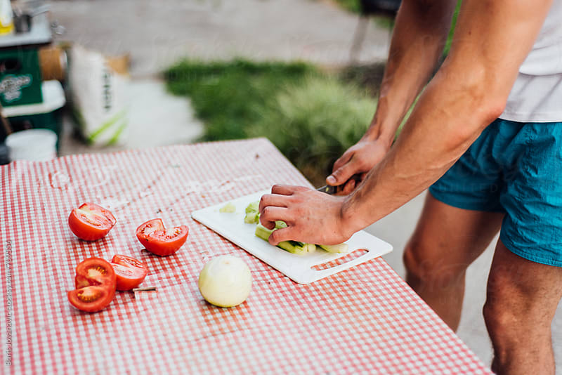 Man making a salade by Boris Jovanovic for Stocksy United