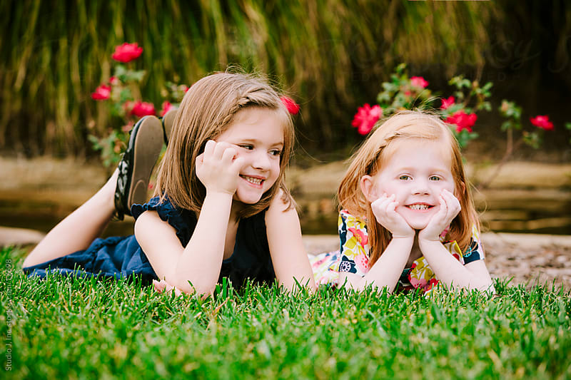 Little Girl Sisters at Rest Outside by Jani Bryson for Stocksy United