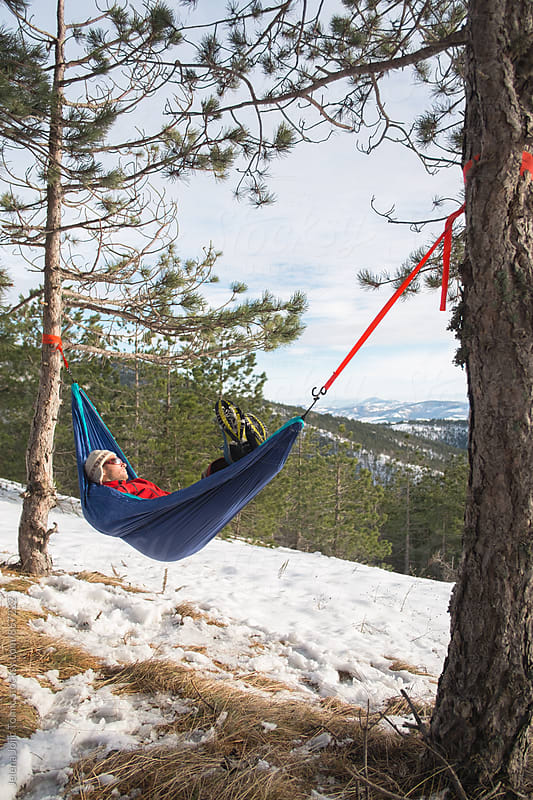 Mountaneer is relaxing in a hammock by Jelena Jojic Tomic for Stocksy United