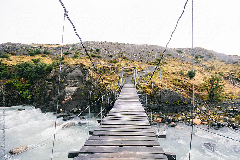 Suspension bridge over river in Torres del Paine, Chile by Alejandro Moreno de Carlos for Stocksy United