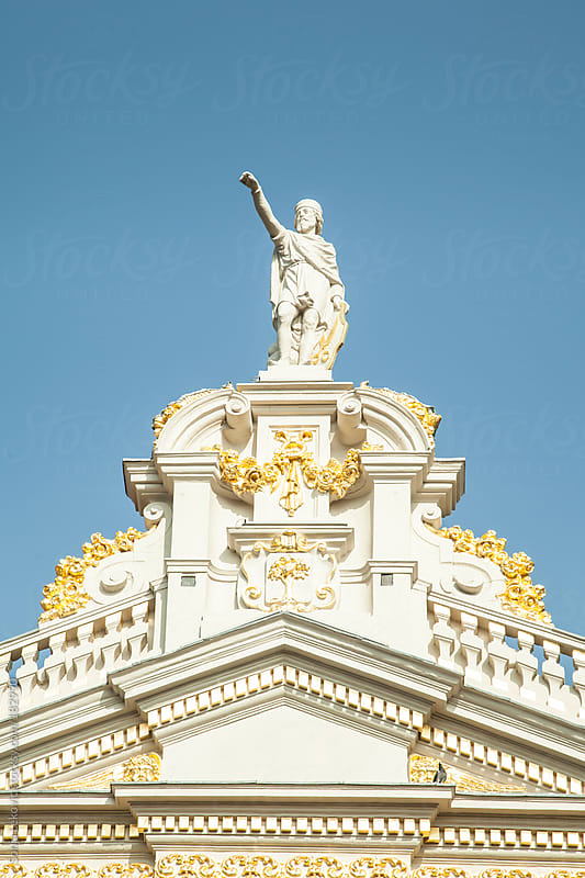 statue and gold ornaments on top of the building by Sonja Lekovic for Stocksy United