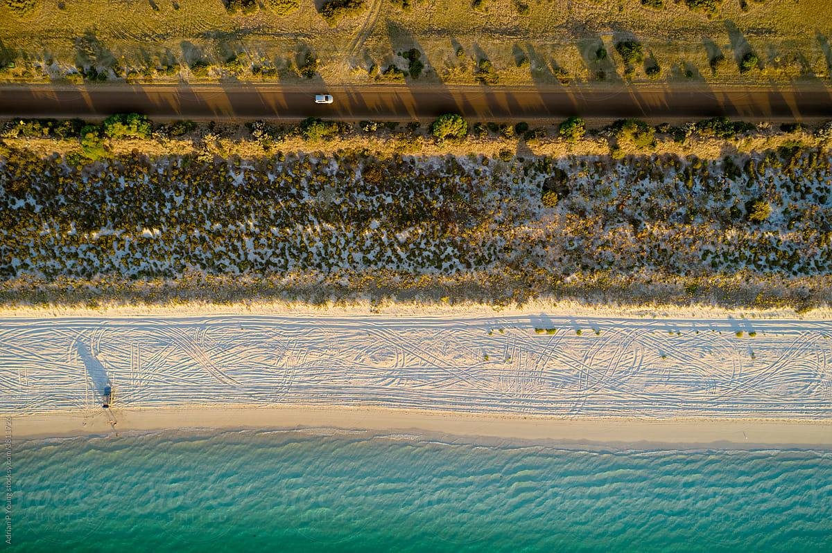 Driving by beach aerial