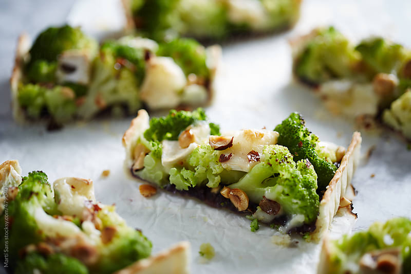 Preparing homemade broccoli tart by Martí Sans for Stocksy United