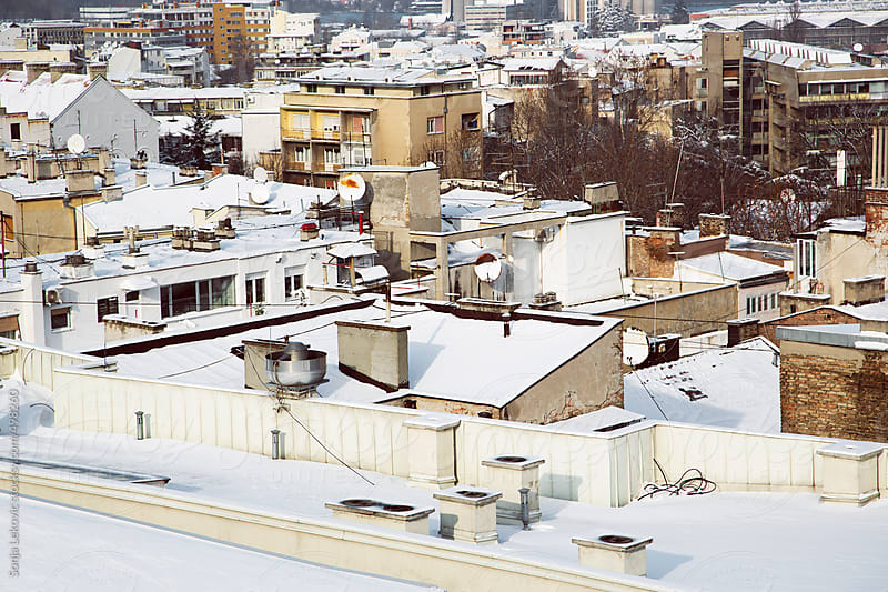 city rooftops at winter by Sonja Lekovic for Stocksy United
