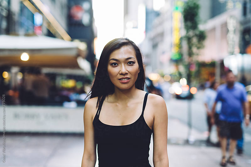 Asian woman walking downtown by Good Vibrations Images for Stocksy United