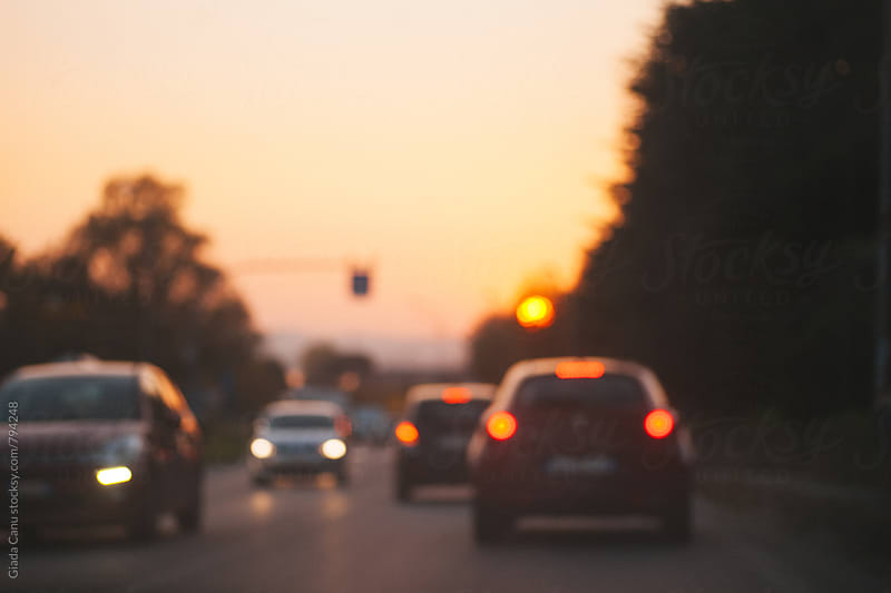 Driving at dusk by Giada Canu for Stocksy United