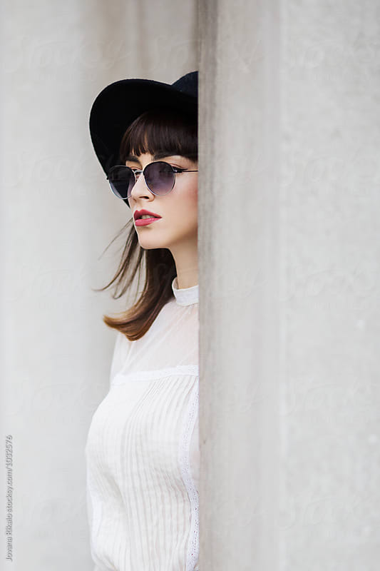 Stylish young woman wearing sunglasses by Jovana Rikalo for Stocksy United