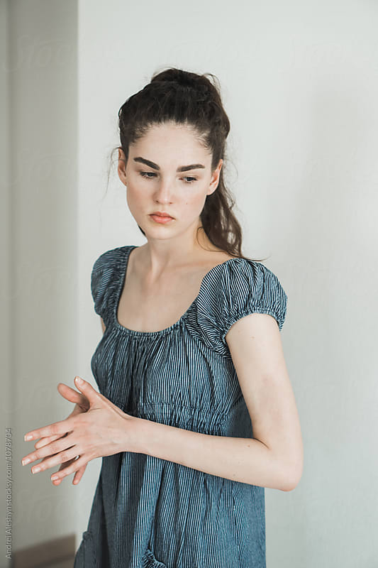Beautiful young slim girl in a dress by Andrei Aleshyn for Stocksy United