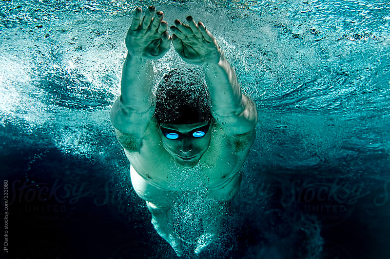 underwater olympic swimming breaststroke glide by jp danko for stocksy united