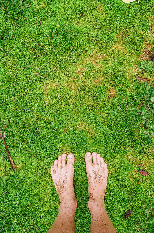 Feet and wet grass, Samoa. by Thomas Pickard for Stocksy United