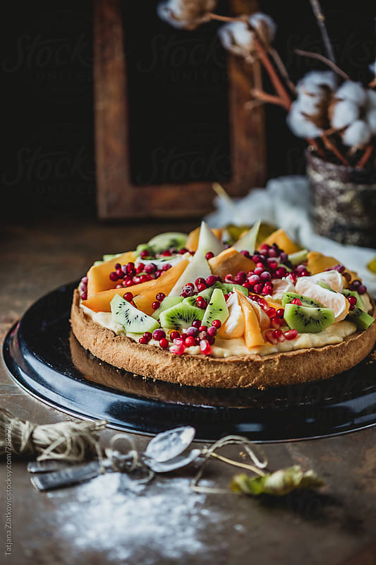 Homemade tart with fruit by Tatjana Zlatkovic for Stocksy United