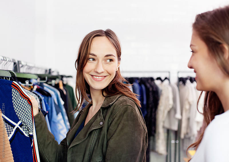 Best friends shopping for clothes by W2 Photography for Stocksy United