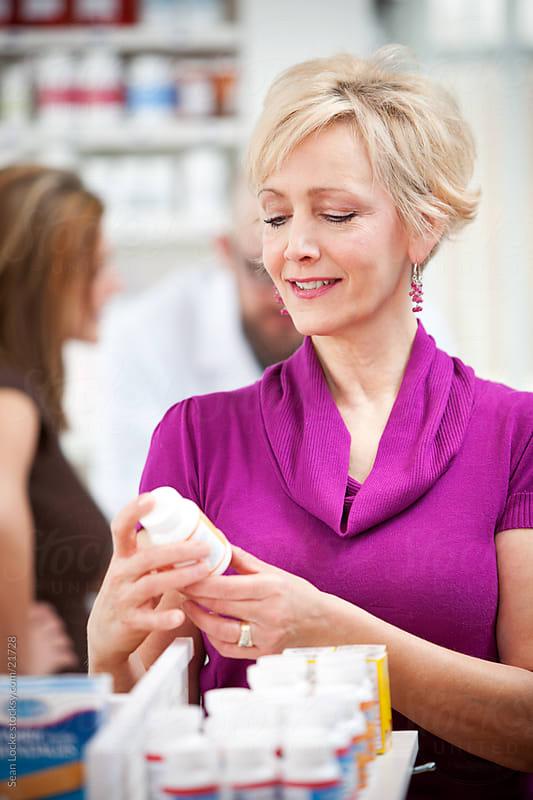 Pharmacy: Senior Woman Reads Medicine Label by Sean Locke for Stocksy United